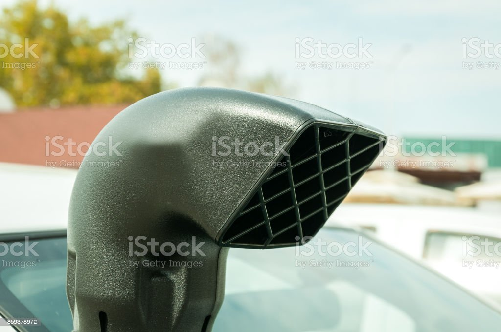 Top of big plastic car snorkel for air intake installed on the off road vehicles to be used in extreme driving conditions stock photo