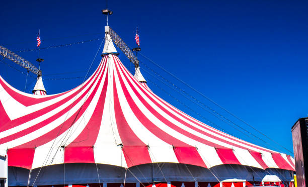 Top Of Big Top Circus Tent Top Of Red & White Striped Big Top Circus Tent entertainment tent stock pictures, royalty-free photos & images
