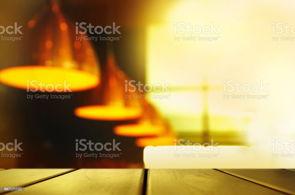 top of black wood texture counter bar with row of metal lamp with cozy warm orange light interior background stock photo