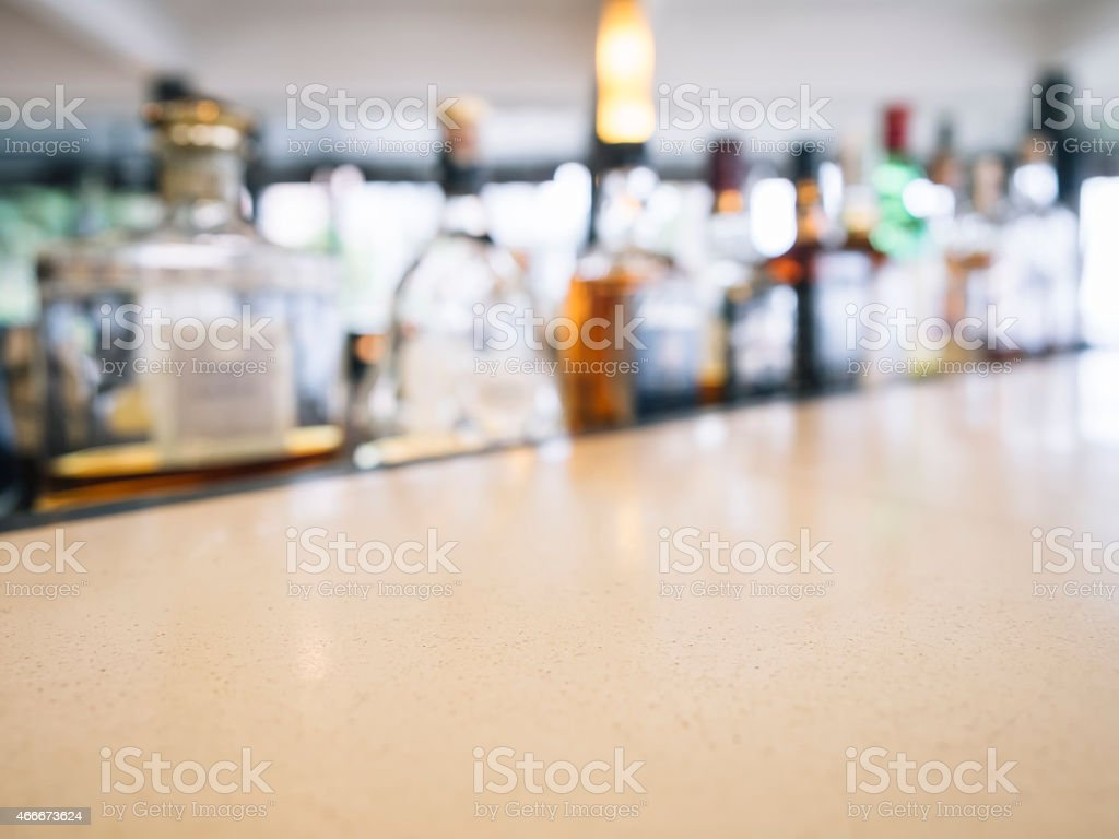 Top of counter Bar with Blurred beer bottle Restaurant Interior stock photo