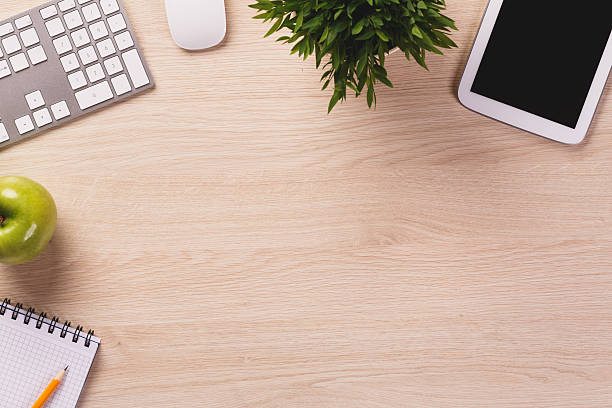Top of desk with empty space and office equipment. stock photo