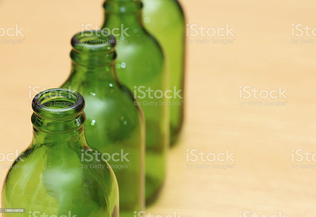 Top of four green bottles stock photo