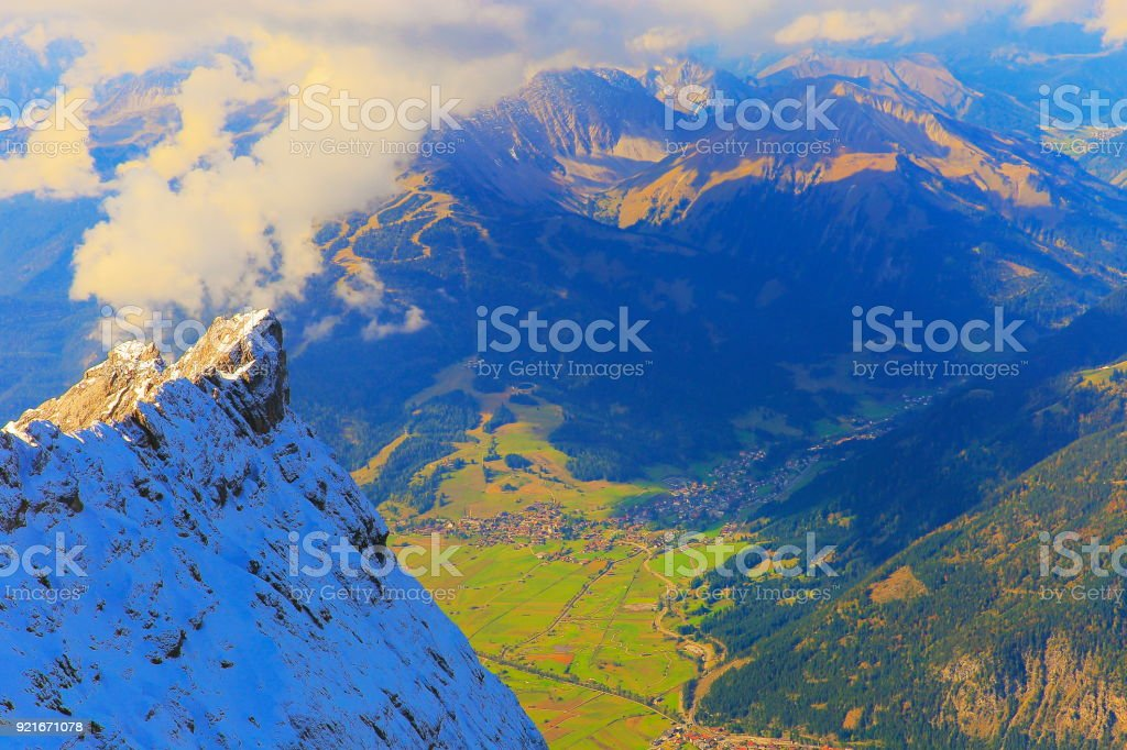 Top of Germany: Zugspitze summit and tirol side – Germany border with Ehrwald, Austria stock photo