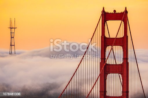 Top of Golden Gate Bridge and Sutro Tower over the clouds in the morning. San francisco, California. USA