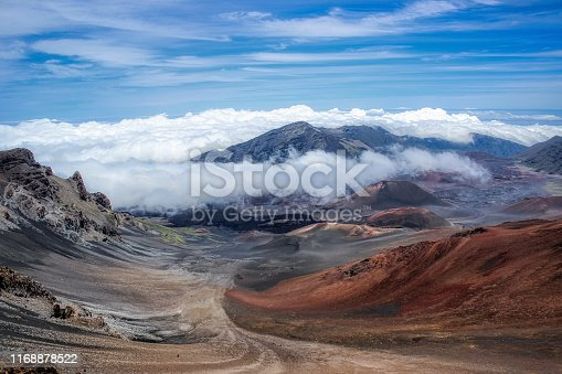Colorful view of volcanic cones and clouds covering the peak of Haleakala Crater in Maui, Hawaii
