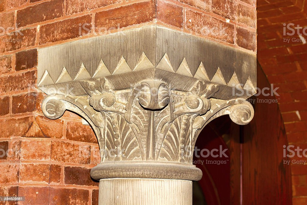 Top (capital) of interior column in the Georgetown University hall. stock photo