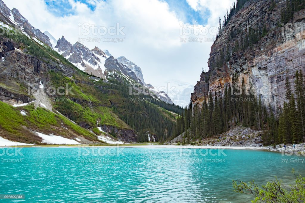 Top of lake louise looking into mountains stock photo
