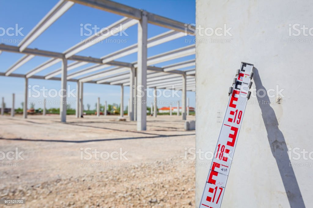 Top of leveling rod for measuring level on construction site stock photo