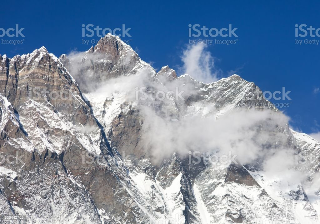 Top of Lhotse with clouds on the top stock photo