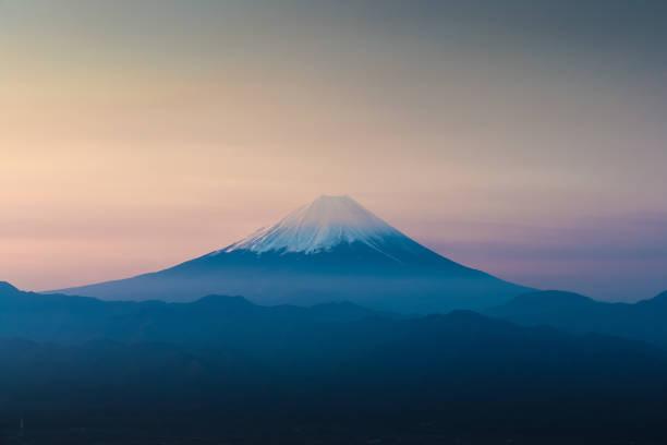Top of Mt. Fuji with sunrise sky in spring season stock photo