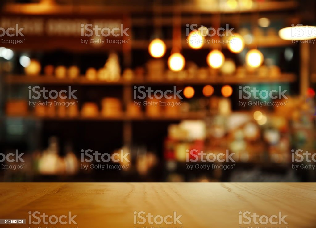 top of nature wood with blur lamp light bar or club cafe background - foto stock