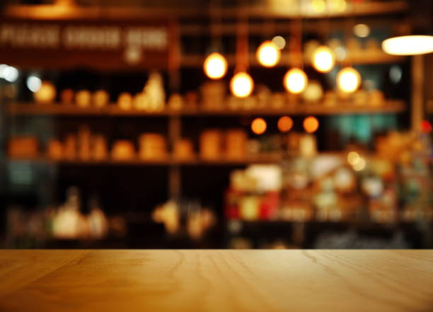 top of nature wood with blur lamp light bar or club cafe background - bar top stock photos and pictures