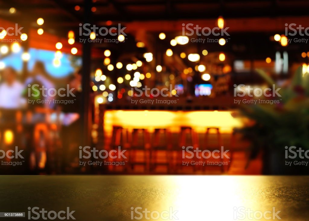 top of reflection bokeh light on table with blur bar light party background stock photo