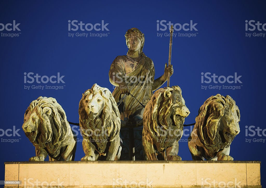 Top of Siegestor triumphal arch in Munich, Germany at night royalty-free stock photo
