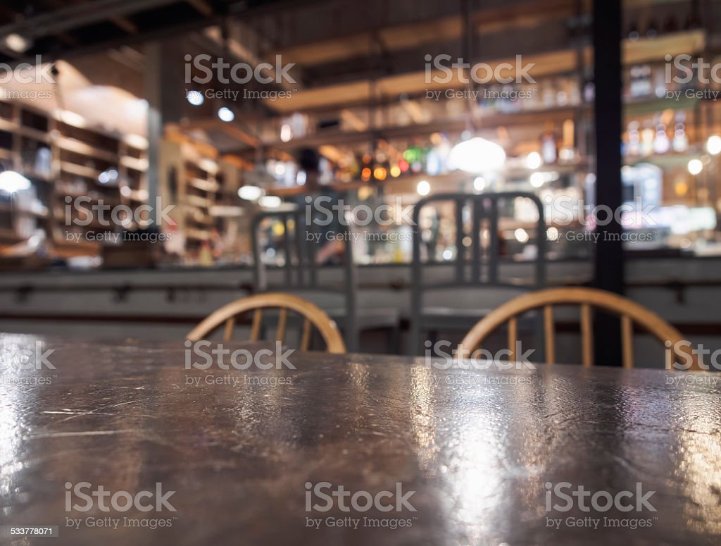 Top of table with Bar Restaurant blurred background with bartender stock photo