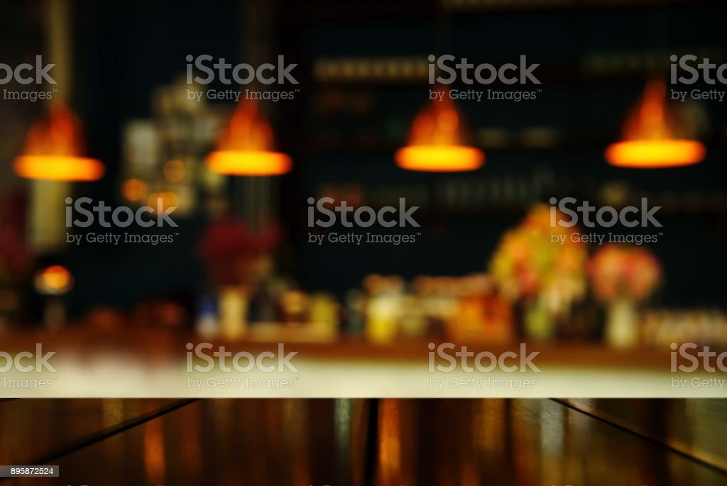top of table with blur lamp of counter bar or club at night for party or celebrate background stock photo