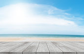 Top of the empty wooden table with a summary of beach and sky and natural light of summer. For trade shows and advertising and promotion.