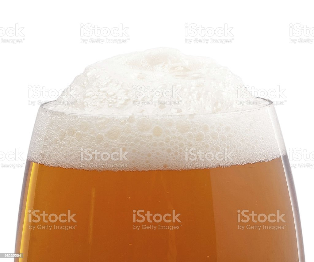 Top of the glass with beer foam royalty-free stock photo