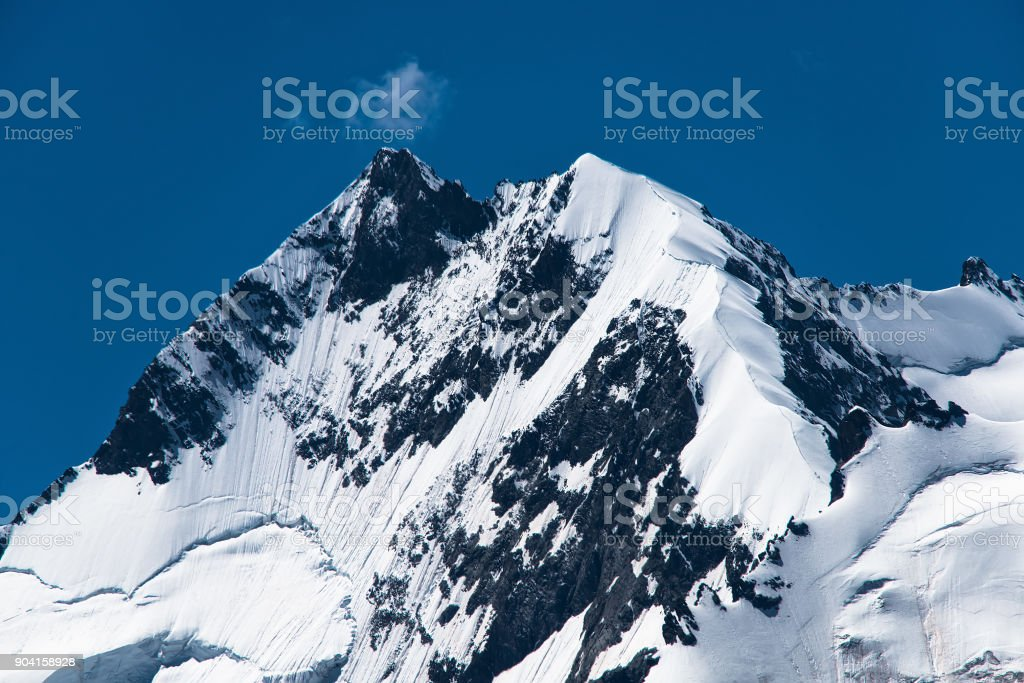 Top of the Rhaetian Alps Pizzo Bernina with the biancograt crete route stock photo