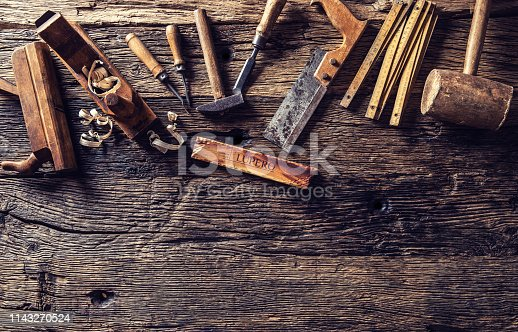 Top of view vintage carpenter tools in a carpentry workshop.
