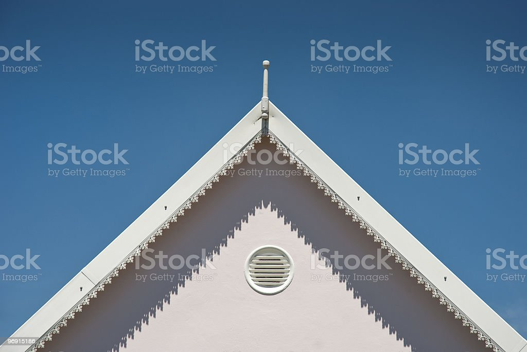 Top of white roof with blue skies royalty-free stock photo