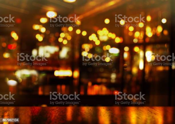 Top of wood table and party light of bokeh in bar at night background picture id867962104?b=1&k=6&m=867962104&s=612x612&h=fnctcv6oh04qe5f9cqrvpqtkalbntq pxp0rqp4ccna=