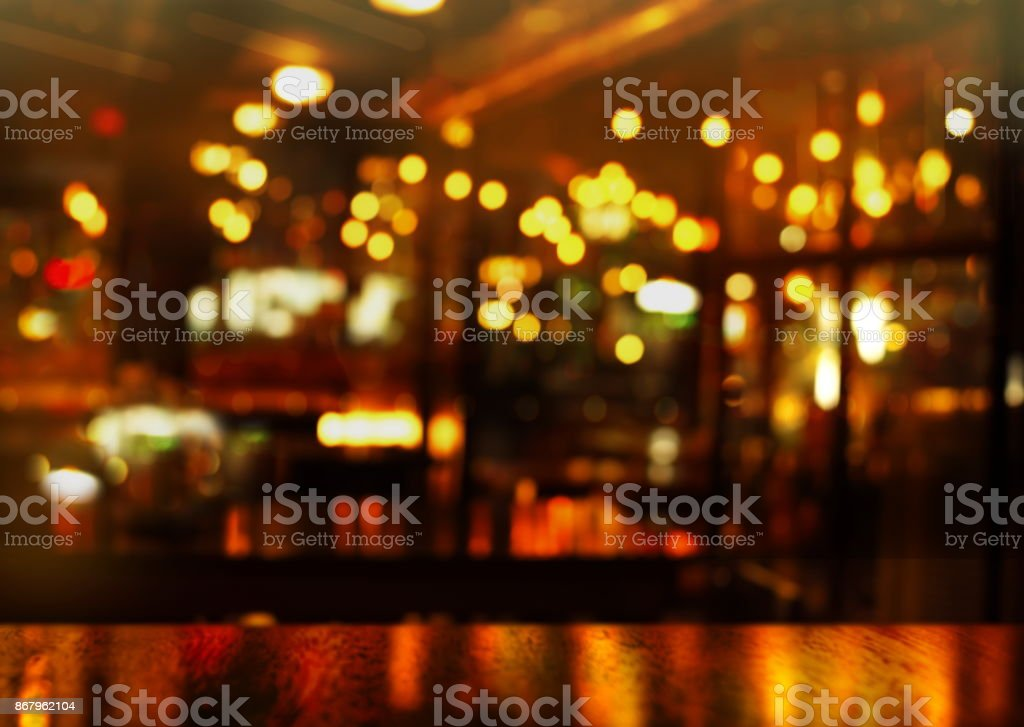 top of wood table and party light of bokeh in bar at night background stock photo