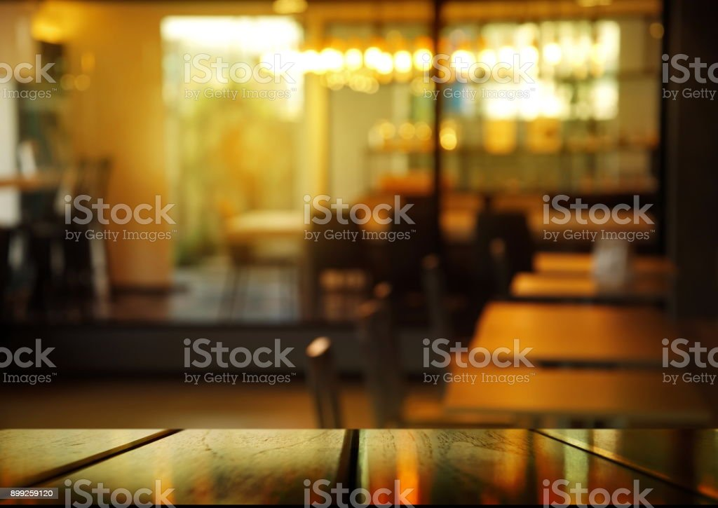 top of wood table with blur cafe or pub at night background stock photo