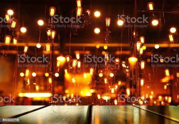 Top of wood table with blur light orange lamp of bar or pub for party picture id850932218?b=1&k=6&m=850932218&s=612x612&h=1 d5vesdb8pcd cpe9drqdnnax6gvjap4jxad4ccu1u=