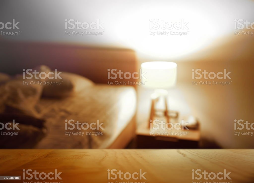Top Of Wood Table With Blur Night Bedroom Lamp House Interior Background Royalty Free