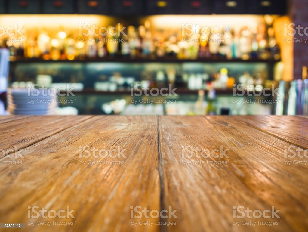 Top of Wooden Table Blur Bar Restaurant background royalty-free stock photo