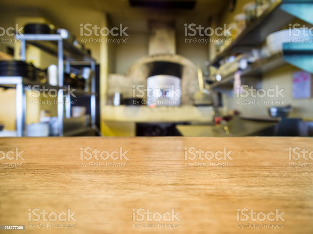 Le dessus de Table en bois avec fond flou Restaurant Kitchen - Photo