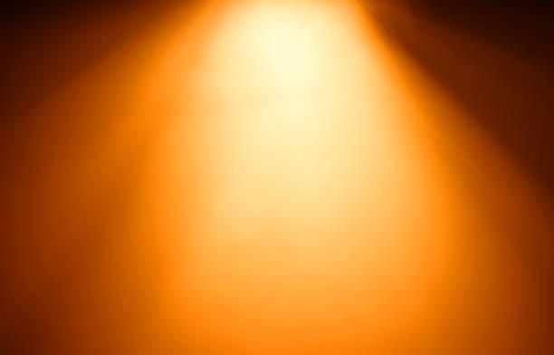 Top orange ray of light bokeh background stock photo