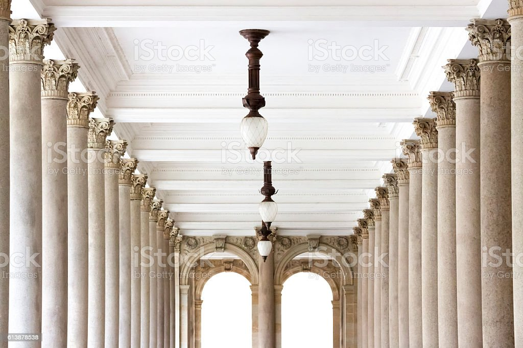 Top part of classical columns with ceiling in colonade stock photo