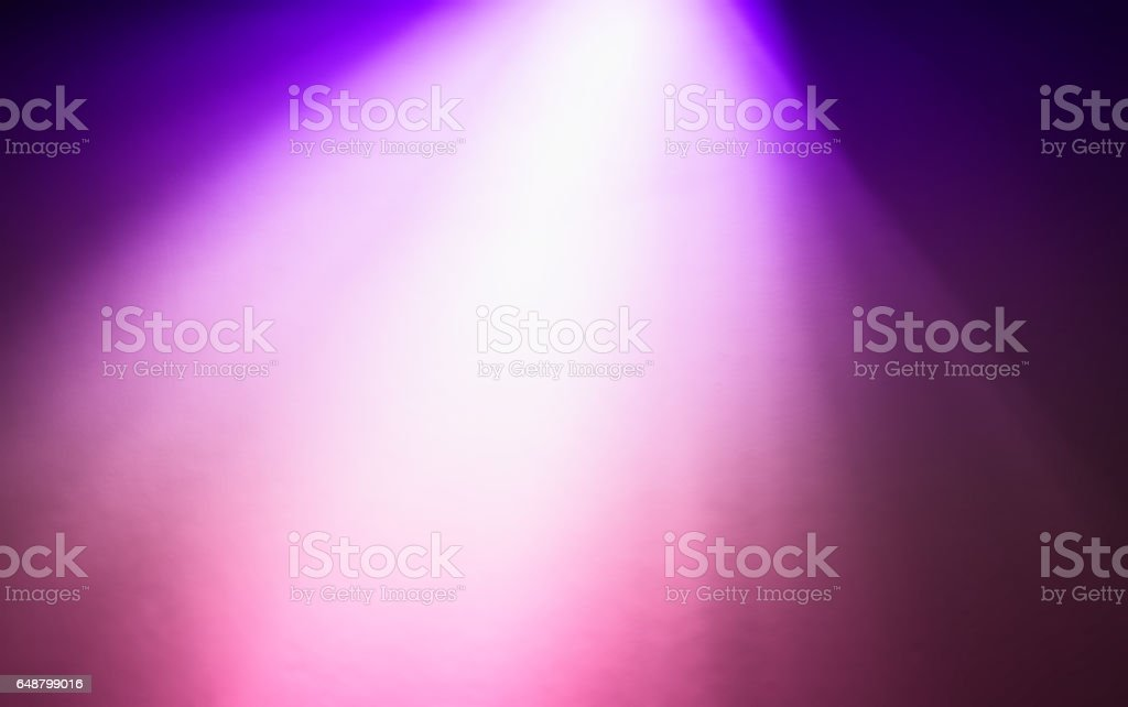 Top purple pink ray of light bokeh background stock photo