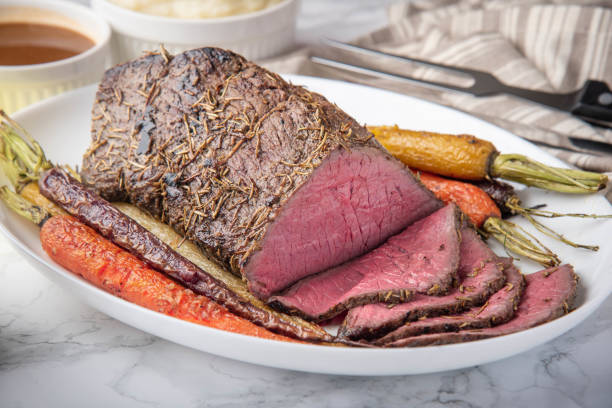 top round roast beef with carrot and mushed potato stock photo