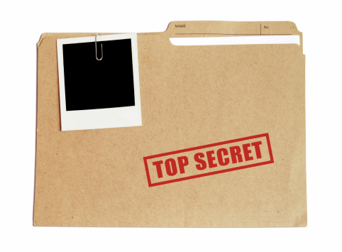 Top secret folder with document and picture