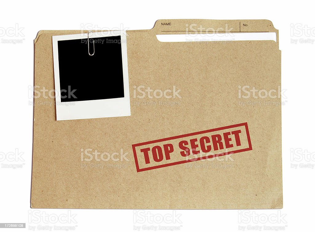 Top secret file in a folder with a Polaroid attached stock photo