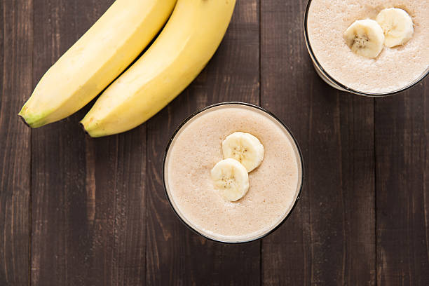 Top shot banana smoothie on wooden table stock photo