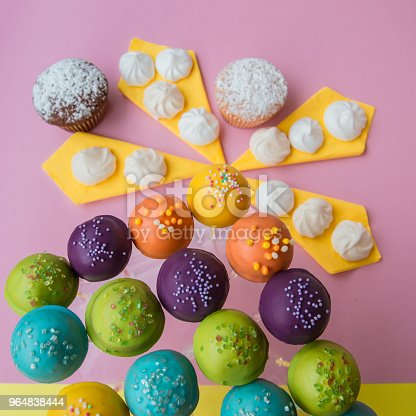 Top Side View Of Cake Pops On A Colorful Pink With Yellow Background Stock Photo & More Pictures of Baked