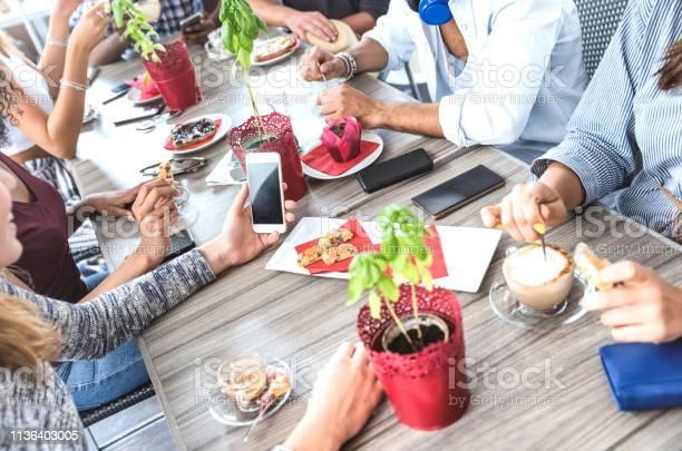 Top side view of friends drinking cappuccino at coffee shop people picture id1136403005?b=1&k=6&m=1136403005&s=612x612&h=rrey4 s03xthzsgifjprlpkq0orwdc jw7omhqvl tq=