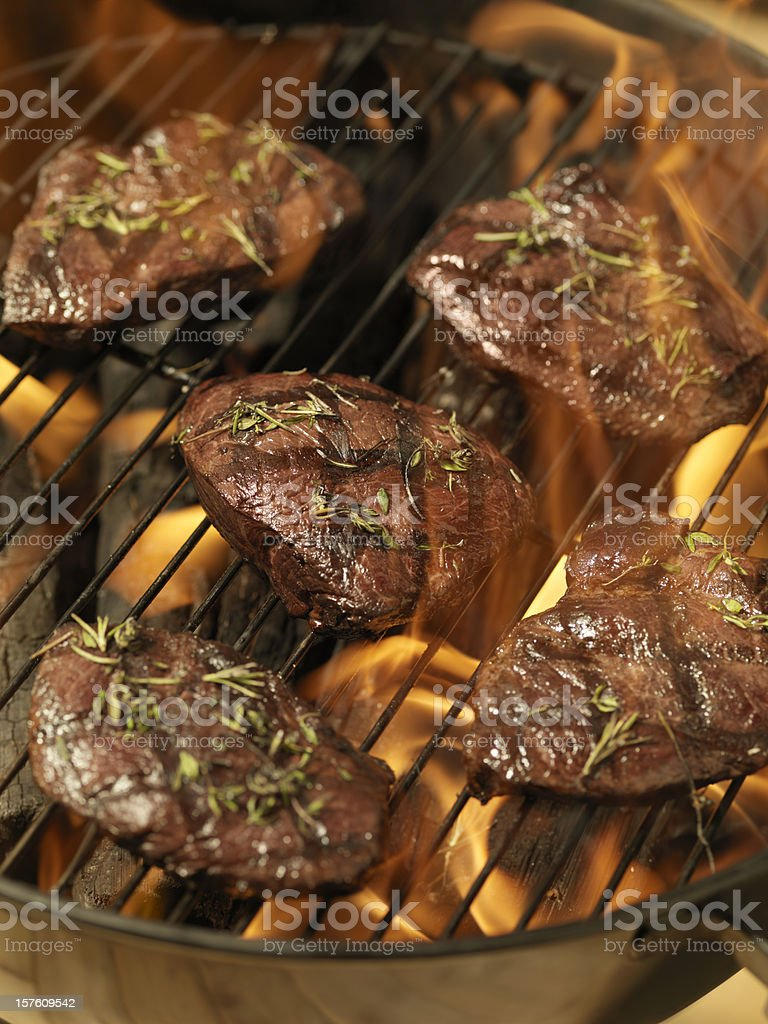 Top Sirloin Steaks on an outdoor BBQ royalty-free stock photo