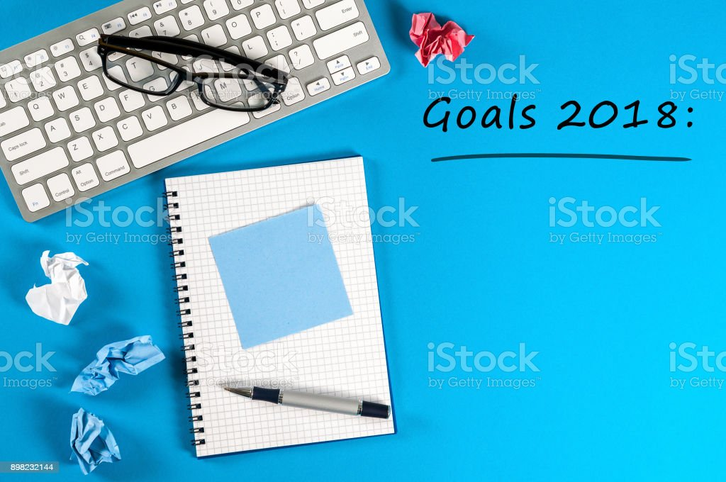 Top View 2018 Goals List With Keyboard Office Supplies On Blue Desk Targets  Goal Dreams And New Years Promises For The Next Year Stock Photo -