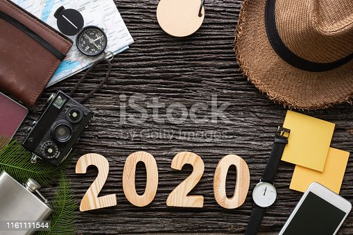 istock top view 2020 happy new year number on wood table with adventure accessory item,holiday vacation planning 1161111544