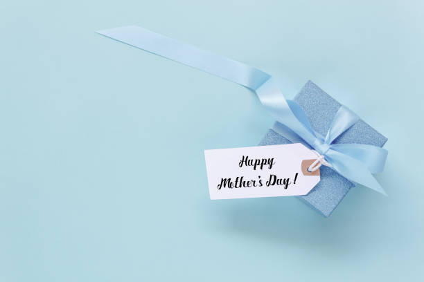 top view aerial image of decoration happy mother's day holiday background concept.flat lay mom white card with blue gift box on beautiful modern grunge paper at home office desk.free space for design. - happy mothers day type stock photos and pictures