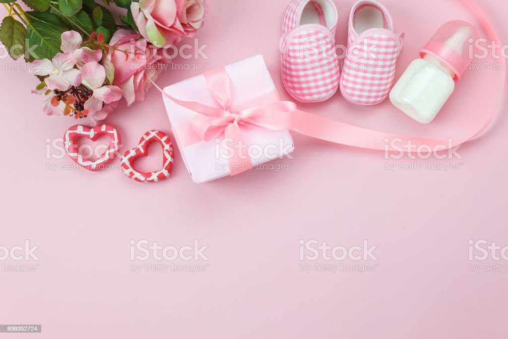 Top view aerial image of decoration Happy mother's day holiday background concept.Flat lay gift box with items on modern beautiful pink paper at home office desk.Negative space for creative design. stock photo