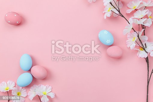 istock Top view aerial image of decoration & symbol Happy Easter holiday background concept.Flat lay accessory bunny eggs & floral on modern beautiful pink paper at home office desk.Free space for design. 925108576