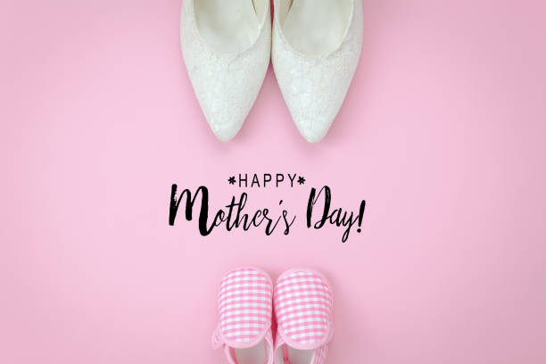 top view aerial image of decorations happy mothers day holiday background concept.flat lay object woman & kid shoes on modern beautiful pink paper at home office desk.text season for creative design. - happy mothers day type stock photos and pictures