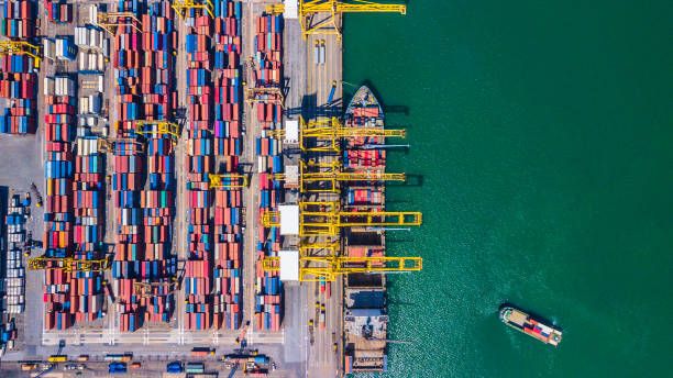 top view aerial view of deep water port with cargo ship and container singapore - logistica foto e immagini stock