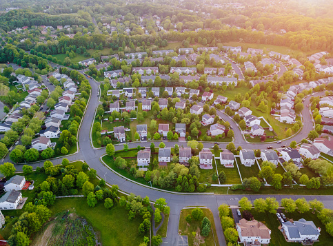 Aerial top view with from flying drone over residential district development buildings transportation